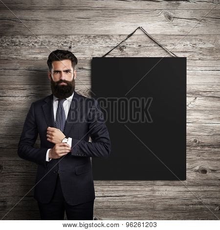 Black poster hanging leather belt on wood background and bussinesman