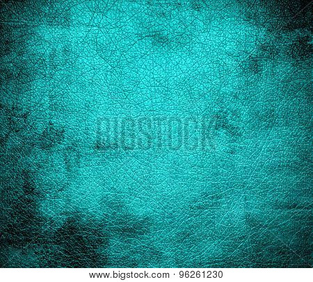 Grunge background of dark turquoise leather texture