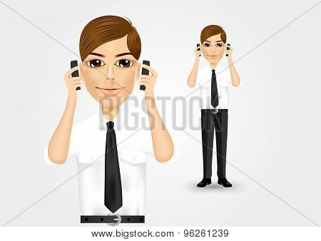 businessman talking on two cell phones