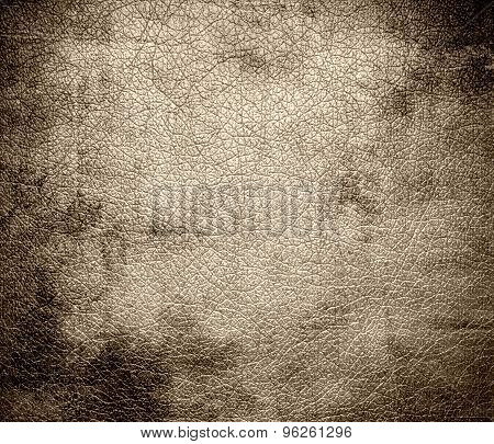 Grunge background of dark vanilla leather texture
