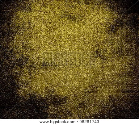 Grunge background of dark yellow leather texture