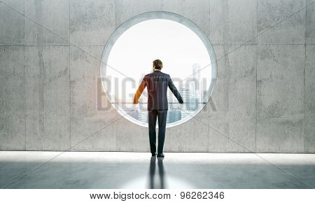 Blank interior and man in a suit.