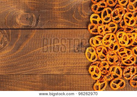 Typical Bavarian Pretzel On Old Wooden Table