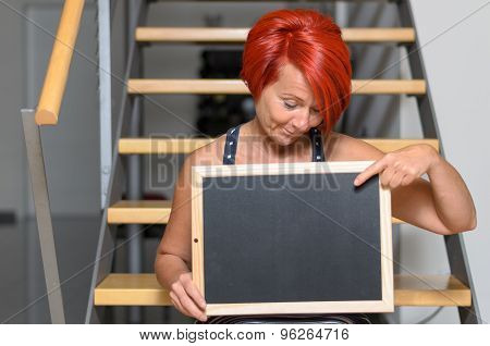 Redhead Woman Holding Small Board With Copy Space