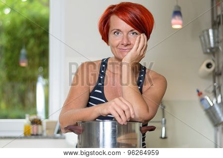 Smiling Woman Leaning Her Arms On Cooking Pot