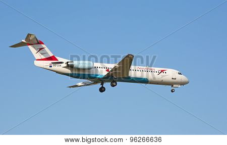 ZURICH - JULY 18: Embraer 190, Austrian landing in Zurich after short haul flight on July 18, 2015 in Zurich, Switzerland. Zurich airport is home for Swiss Air and one of the biggest European hubs.