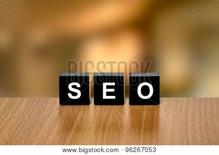 Seo Or Search Engine Optimization On Black Block