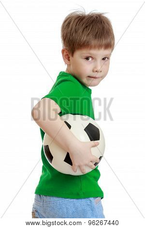 Funny cute little boy in a green t-shirt and jeans