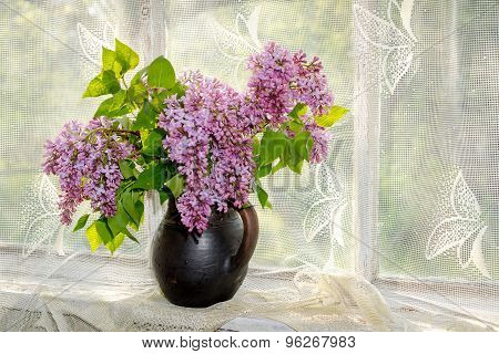 Bunch Lilac In Vase On The Window Sill