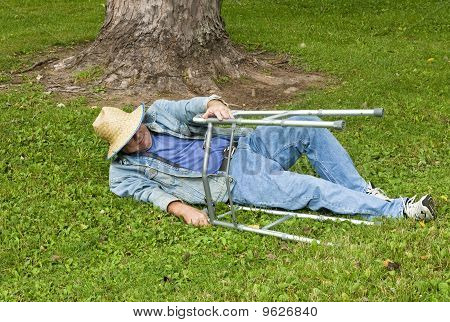 Man With A Walker Falling Down In The Park