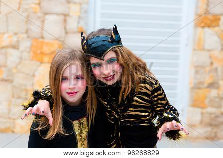 Halloween kid sister girls costume scaring gesture in outdoor