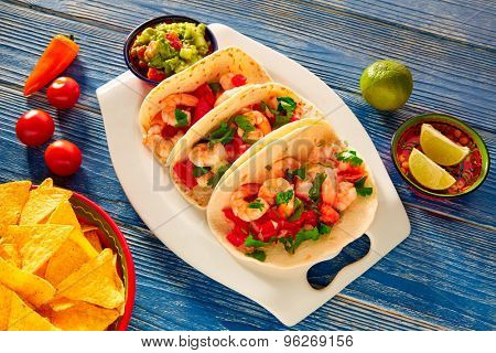 Camaron shrimp tacos mexican food on blue wood table