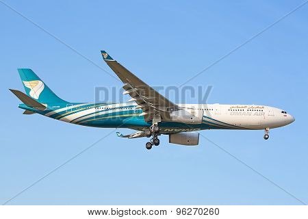 ZURICH - JULY 18: Oman Air A330 landing in Zurich after short haul flight on July 18, 2015 in Zurich, Switzerland. Zurich airport is home port for Swiss Air and one of the biggest european hubs.