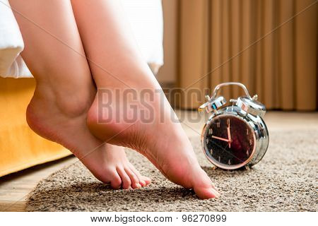 Beautiful Female Legs And An Alarm Clock In The Morning