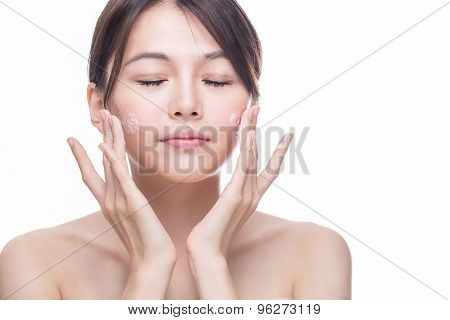 Asian Woman Applying Cream