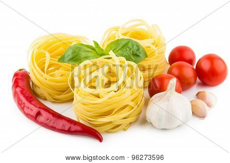 Italian Pasta In Form Nest, Tomatoes, Garlic, Pepper And Basil