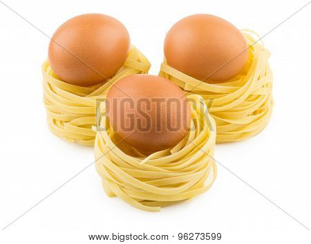 Three Italian Pasta In Form Nest And Brown Egg