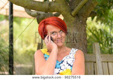 Thoughtful Woman Talking To Someone On Phone