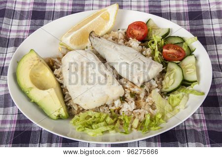 Hake On Fried Jasmine Rice With Lemon, Avocado And Salad