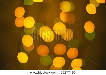 Orange and Green bokeh on a dark background