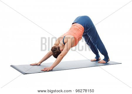 Beautiful sporty fit yogini woman practices yoga asana adhomukha svanasana - downward facing dog pose isolated on white