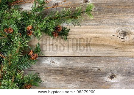 Rough Fir Branches And Cones On Rustic Wooden Boards