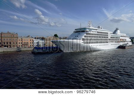 ST. PETERSBURG, RUSSIA - JUNE 23, 2015: Cruise ship Silver Whisper anchored at English Embankment. The liner of company SILVERSEA may accommodate 382 guests