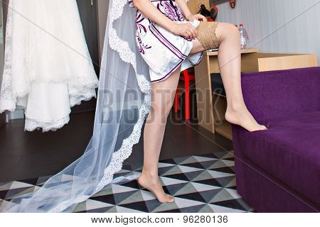 Bride puts on stockings