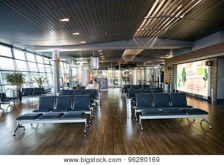 Empty seats in terminal waiting room in airport