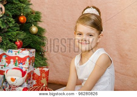 Portrait Of A Fun Five Year Old Girl At The Christmas Tree