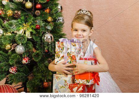Five-year Girl Hugs Christmas Gifts