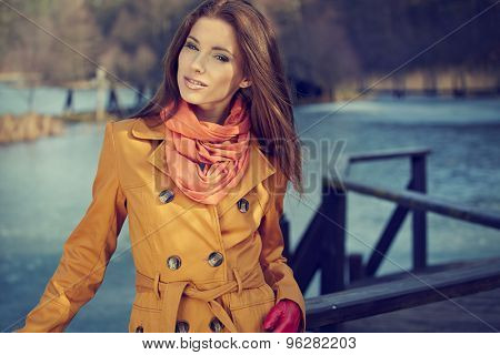 Beautiful vintage woman standing in a park in autumn