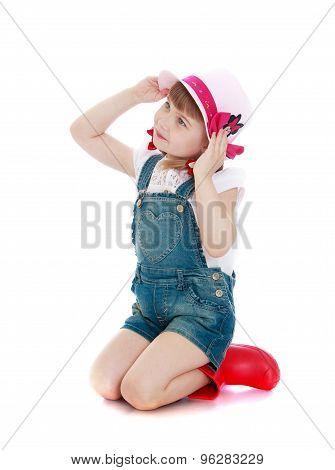 Beautiful little girl in denim shorts