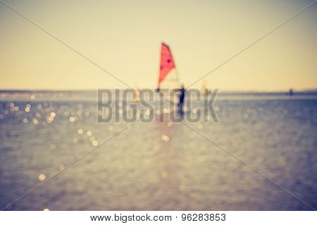 Vintage Photo Of Defocused Seascape With Windsurfers