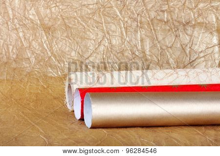 Rolls Of Multicolored Wrapping Paper For Gifts On Abstract Background.