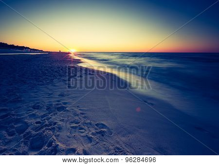 Vintage Photo Of Beach After Sunset
