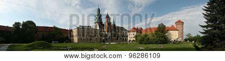 KRAKOW, POLAND - MAY 10, 2009: Tourists in front of the Wawel Cathedral and the Royal Palace on Wawel Hill in Krakow, Poland.