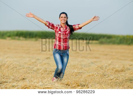 Happy Girl Running In The Field