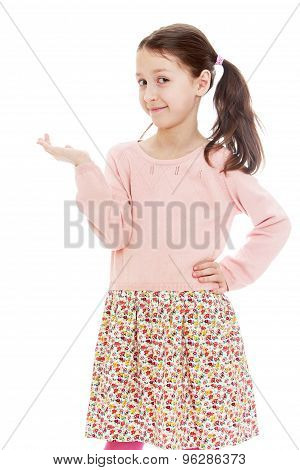 Funny girl schoolgirl in a long calico dress