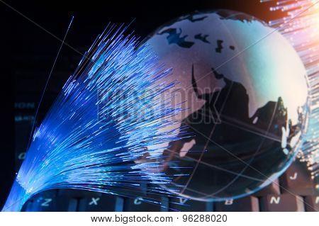 world map technology style against fiber optic background