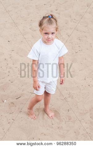Upset Girl Standing On The Sand