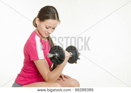 She Shakes Dumbbell Arm Muscles