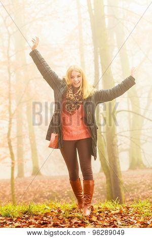 Woman Walking In Park In Foggy Day