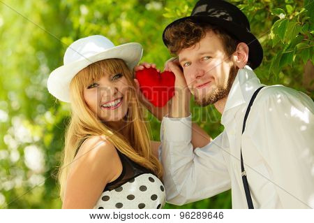 Retro Style Couple In Love With Red Heart