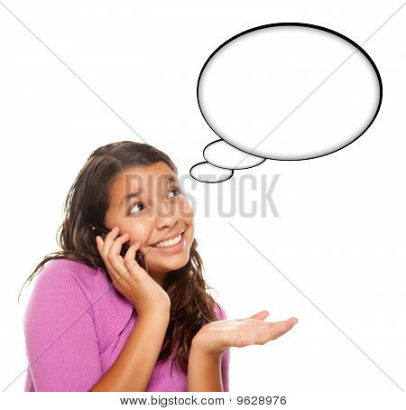 Hispanic Teen Aged Girl On Cell Phone With Blank Thought Bubble