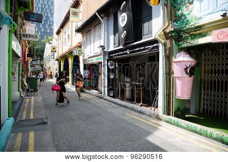 SINGAPORE - CIRCA FEBRUARY, 2015: Tourists in the Arab quarter (Kampong Glam). The Arab Quarter is the oldest historic shopping district of Singapore, is very popular for visits by foreign tourists.