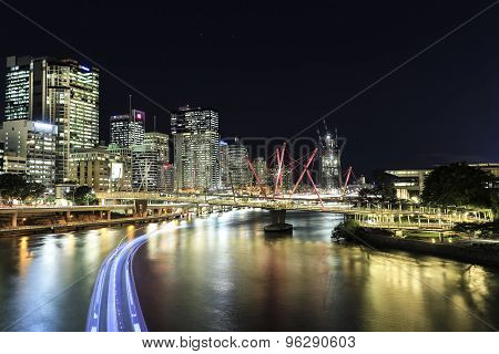 Brisbane Cityscape and Kurilpa Bridge at night, citycat trails