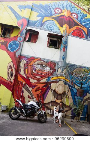 SINGAPORE - CIRCA FEBRUARY, 2015: Street art in Haji Lane. Haji Lane is the Kampong Glam neighbourhood famous for independent fashion and Middle Eastern cafes.