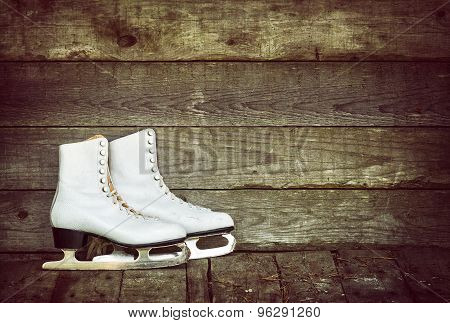 Old Ice Skates Against Rustic Background