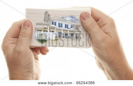 Male Hand Holding Stack of Flash Cards with House Drawing Isolated on a White Background.